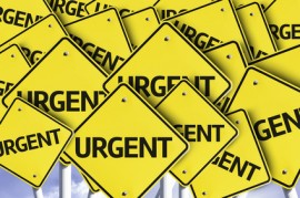 Urgent written on multiple road sign