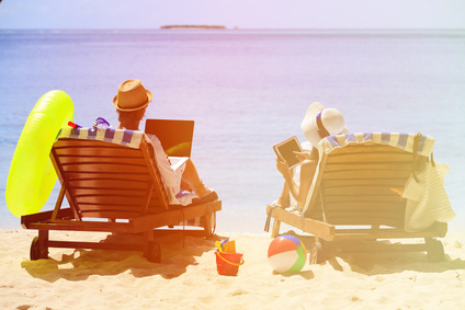 happy young couple surfing the net and enjoy beach vacation